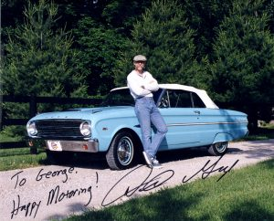 Dennis Gage Standing by Car